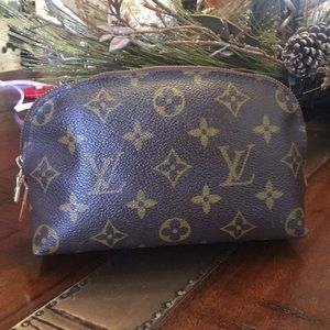 Authentic Louis Vuitton cosmetic bag.